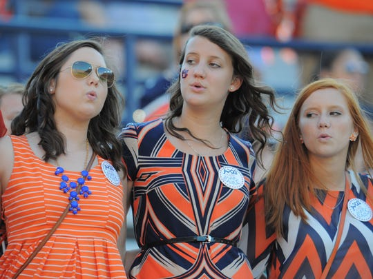 Auburn University students sing the alma mater after a game at Jordan Hare Stadium in Auburn, Ala.