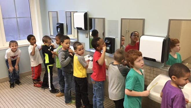 Young students at Oyler School get a lesson in wielding the toothbrush, and they're winning at it.