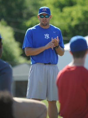 North Forrest head coach Andy Pittman speaks to his team during practice on Friday.