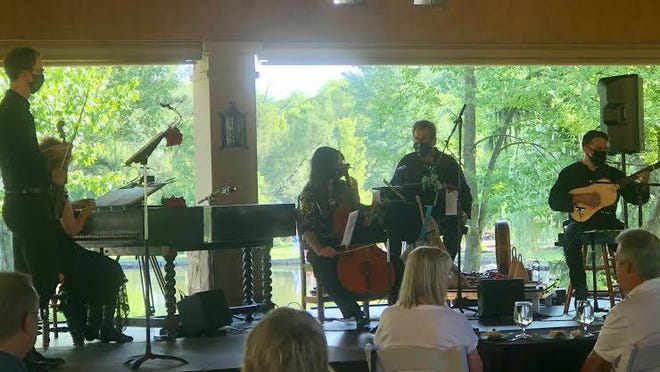 """Apollo's Fire musicians Andrew Fouts, from left, Jeannette Sorrell, Kivie Cahn-Lipman, Jamey Haddad and Brian Kay perform """"Tuscan Sun"""" at Gervasi Vineyard in North Canton Friday."""