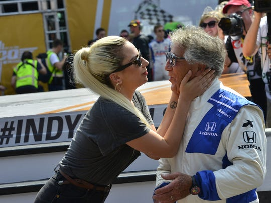 Lady Gaga and Mario Andretti before the start of the 100th running of the Indianapolis 500 Sunday, May 29, 2016.