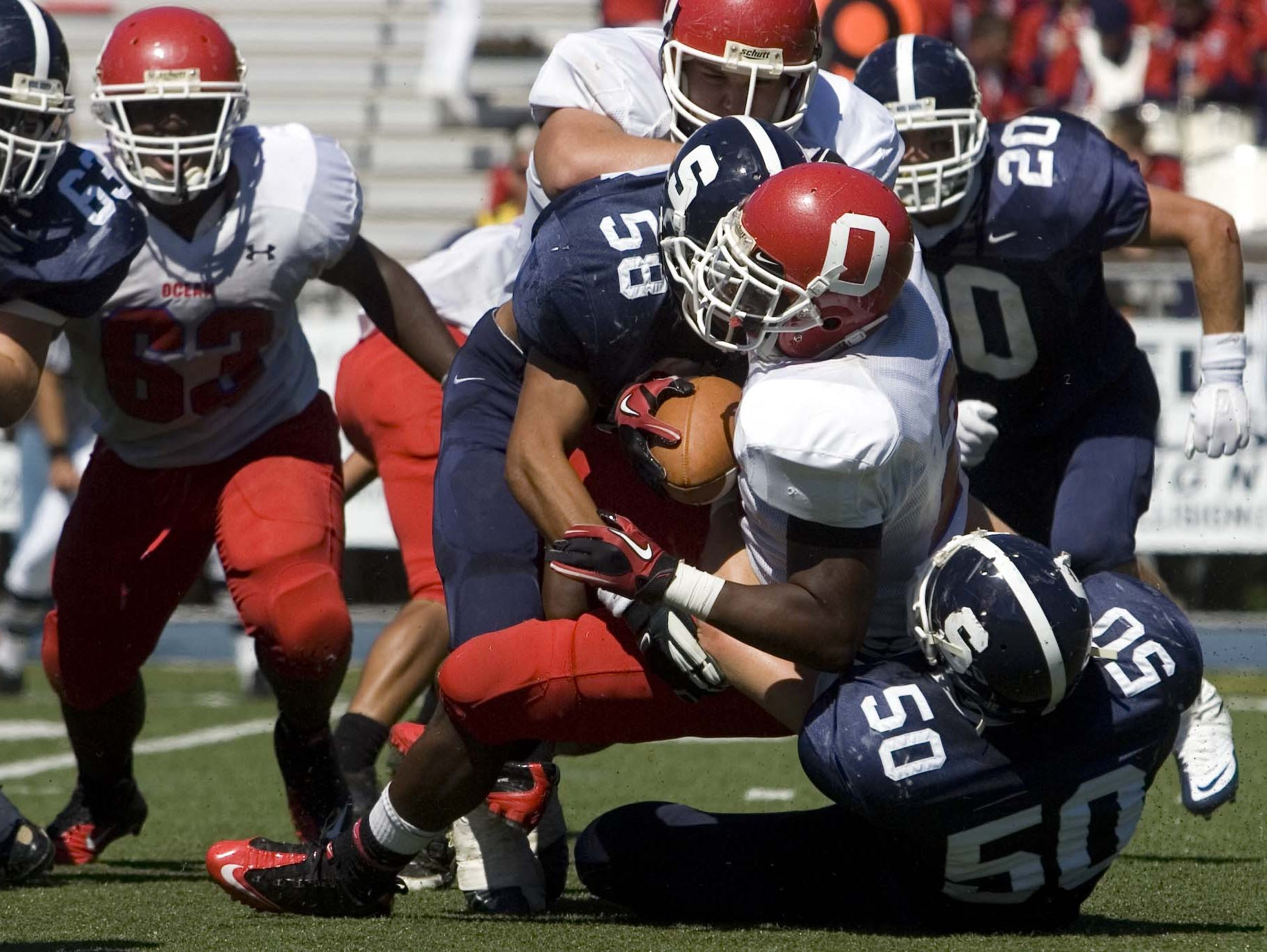 Rick Lovato Jr. (50) helps make a tackle for Middletown South in a 2010 game against Ocean. Lovato, a long snapper for four years at Old Dominion, is hoping for a chance to play in the NFL.