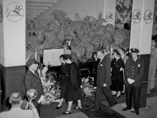 In this August 1948 file photo, Claire Ruth, center left, flanked by Mr. and Mrs. Richard Flanders, son-in-law and adopted daughter of Babe Ruth, as they pass the casket containing his body in the rotunda of Yankee Stadium in New York.
