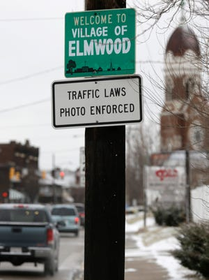 A sign advising motorists they may be monitored by traffic cameras remained in place in Elmwood Place after the cameras were removed by a ruling from Hamilton County Common Pleas Judge Robert Ruehlman. (AP Photo/Al Behrman)