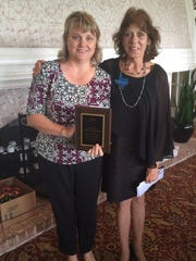 Lori Sheppard, left, accepted a $1000 grant for the Holocaust Museum from Lynne Hamilton.