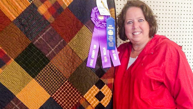 Janet Flint is pictured with her quilt and merit award from entering her work in the Dodge County Fair.