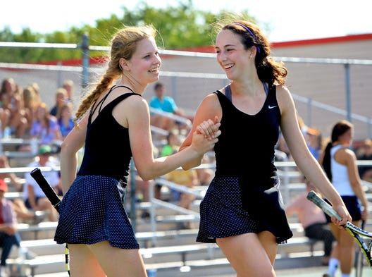 North Central's No. 1 doubles players Kit Sommers, left, and Allie McKenzie congratulate each other after their 7-6, 6-2 win over Cathedral's Kelsey Kopf and Emily Gutrich. North Central won four of the five matches, losing only in No. 3 singles.
