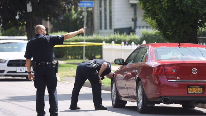 Officers investigate on North Street near Street Stanislaus Street Thursday afternoon.