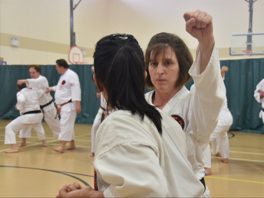 In February 2017, FLORIDA TODAY's entertainment reporter Jennifer Sangalang, back to camera, tested for Ni-Dan or second-degree black belt at the Viera Regional Center.