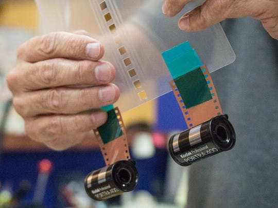 Film is taped to a plastic card that pulls the film through the developing processor.