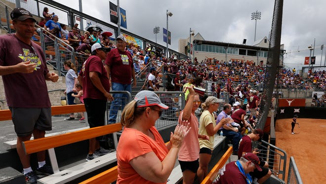 Vernon fans cheer as their team scores against Liberty Hill during the Lady Lions' first appearance at the Class 4A UIL State Tournament at McCombs Field in Austin, Thursday. Liberty Hill defeated Vernon, 6-2. The Lady Lions finished 24-8.