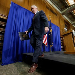 Indiana Gov. Mike Pence steps off the podium after a news conference discussing the state's new religious freedom law on March 31, 2015, in Indianapolis.