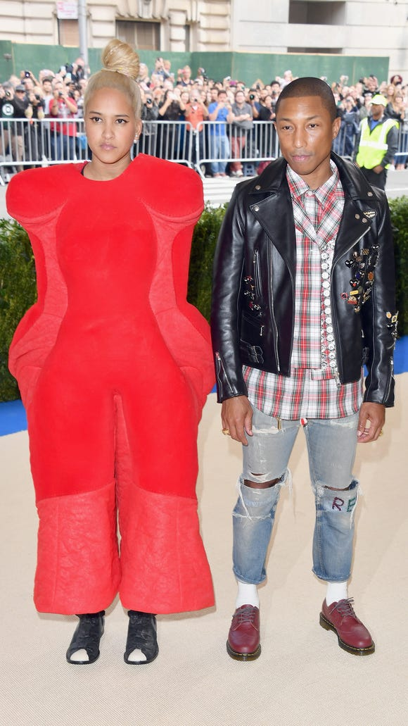 Helen Lasichanh and  Pharrell Williams made bold fashion