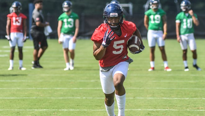 Ole Miss' receiving group is deep and its staff is high on performance of DeMarkus Lodge (5).