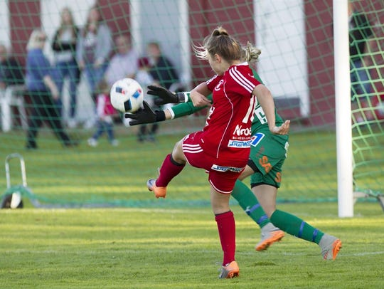 Jade Flory hits a shot that the goalkeeper tries to