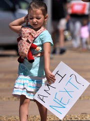Caroline Macaluso, 4, carries a sign during the March for Our Lives at Abilene City Hall Saturday March 24, 2018. Led by young people, groups from cities across the nation marched to demonstrate against gun violence and to call for stricter gun laws.