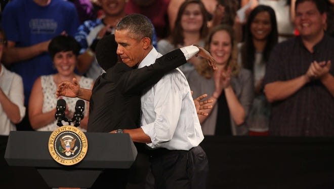 Russhaun Johnson, student body president of North High School gives a hug to President Barack Obama after introducing him to the crowd on Monday, Sept. 14, 2015 at North High School in Des Moines.