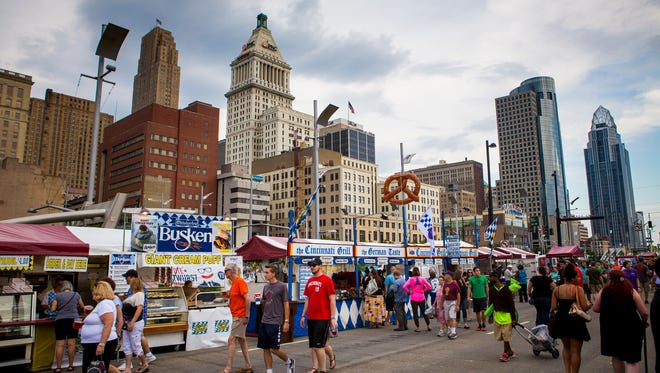 Crowds gather at Oktoberfest Friday, September 16, 2016, at the new location on Second Street and Third Street in downtown Zinzinnati.
