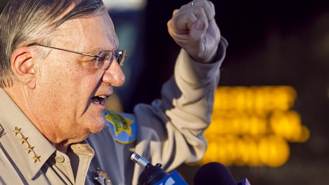 Then-Maricopa County Sheriff Joe Arpaio answers questions during a press conference at the MCSO Surprise station in 2009.