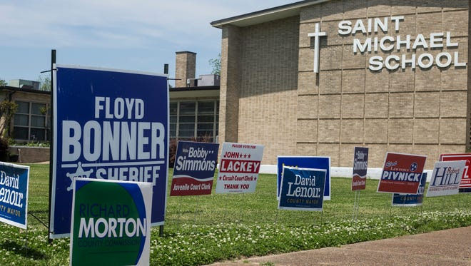 May 01, 2018 - Campaign signs line the entrance to the polling station at St. Michael School on Election Day on Tuesday.