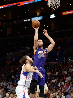 Phoenix Suns center Miles Plumlee (22) shoots against Los Angeles Clippers forward Spencer Hawes (10) during the first half at Staples Center.