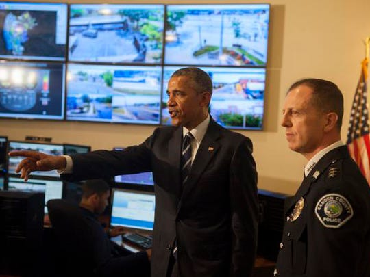 President Barack Obama tours the Real-Time Tatical Operational Intelligence Center in the Camden County Police Administration Building with Camden County Police Chief Scott Thomson on Monday