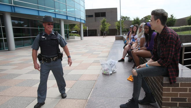 State University of New York Police Officer Dave Halpern greets students on the main plaza at SUNY Purchase on Aug. 22.