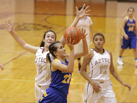 Eastwood's Kaylee Martinez has her shot blocked by El Dorado's Stephanie Encizo in the second half of their game Tuesday.