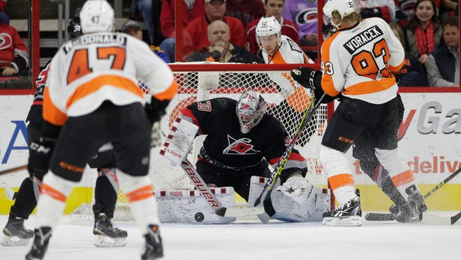 Carolina Hurricanes goalie Cam Ward made 36 saves in beating the Flyers 3-1.