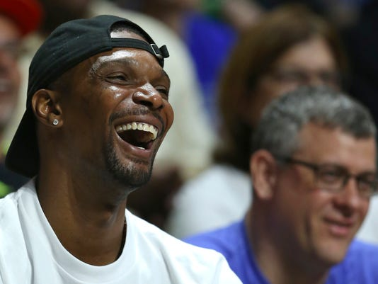 "FILE - In this Saturday, Feb. 25, 2017, file photo, Miami Heat forward Chris Bosh smiles during the first half of an NCAA college basketball game between Miami and Duke in Coral Gables, Fla. Bosh never wanted to take games off as a player, and would give anything to be playing right now. So he has a very simple perspective on the NBA's rest-or-play debate. ""If you can play,"" Bosh said, ""go out there and play."" (David Santiago/El Nuevo Herald via AP, File)"