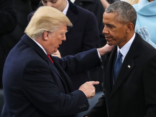 President Trump points at former president Barack Obama