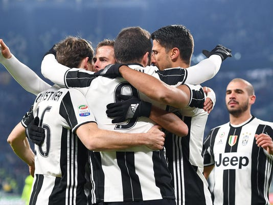 Juventus's Gonzalo Higuain, center with back to camera, celebrates with teammates after scoring during a Serie A soccer match between Juventus and Bologna at Juventus Stadium in Turin, Italy, Sunday, Jan. 8, 2017.  (Alessandro Di Marco/ANSA via AP)