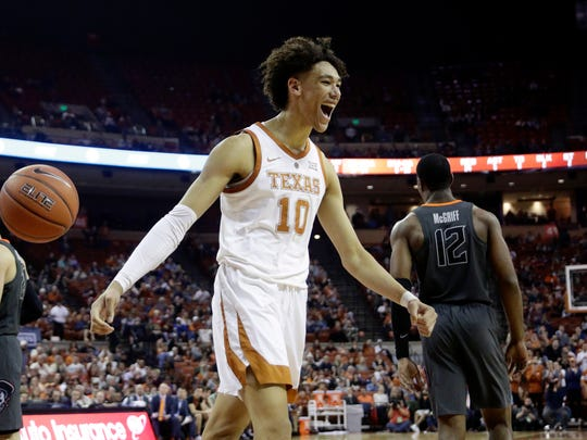 """FILE - In this Feb. 16, 2019, file photo, Texas forward Jaxson Hayes (10) celebrates a play during the second half of an NCAA college basketball game against Oklahoma State, in Austin, Texas. Hayes is the latest one-and-done big man at Texas. Texas announced Thursday, April 11, 2019, the freshman forward will hire an agent and enter the NBA draft, as his meteoric rise from high school bench player barely three years ago into a projected early first-round draft pick this summer continues. """"I have always dreamed about playing in the NBA,"""" Hayes said. (AP Photo/Eric Gay, File)"""
