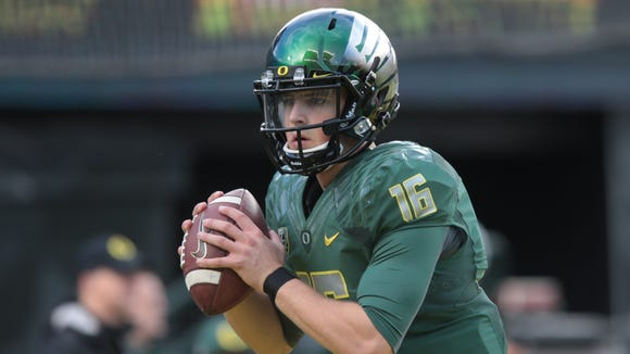Nov 22, 2014; Eugene, OR, USA; Oregon Ducks quarterback Morgan Mahalak (16) throws the ball before the game against the Colorado Buffaloes at Autzen Stadium. Mandatory Credit: Scott Olmos-USA TODAY Sports