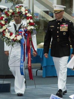 A wreath commemorating the 75th anniversary of the Battle of Midway is placed on display the National Naval Aviation Museum Monday morning June 5, 2017.