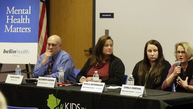 Mental health experts, from left, Hugh Davis, Elizabeth Hudson, Kayla Ostermann and Carol Vorpahl spoke at USA Today Network-Wisconsin's presentation Wednesday at Mead Public Library in Sheboygan. The panel discussed the mental health issues that children face.