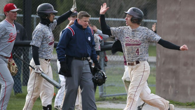 Arcadia's Kevin Blum, right, celebrates after scoring the first run of the game with teammate Alex Rodriguez as he scores on a single by Kyle Bailey in the second inning