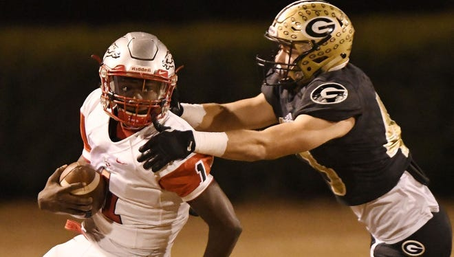 South Pointe quarterback Derion Kendrick (1) tries to get away from Greer linebacker Matthew Mason during the Stallions' 67-21 win over the Yellow Jackets' in the Class AAAA Upper State final Friday night at Dooley Field.