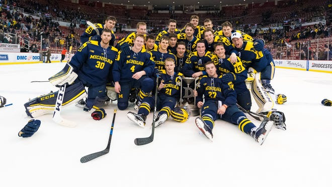 The Michigan hockey team celebrates its 5-4 shoot-out win over Michigan State on Friday, Feb. 10, 2017 at Joe Louis Arena.