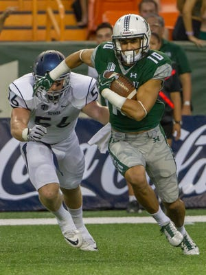 Nevada linebacker Alex Bertrando tries to chase down Hawaii wide receiver Makoa Camanse-Stevens.