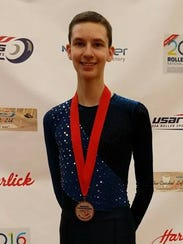 Ian Heersink is pictured with his gold medal.