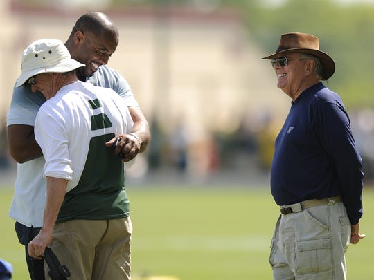 Ron Wolf has seen five of his understudies at Green Bay become GMs. At left, Former Green Bay Packers defensive tackle Santana Dotson hugs head trainer Pepper Burruss as former general manager Ron Wolf watches during training camp practice at Ray Nitschke Field in Ashwaubenon on Friday, Aug. 6, 2010.  Photo by Evan Siegle/Press-Gazette