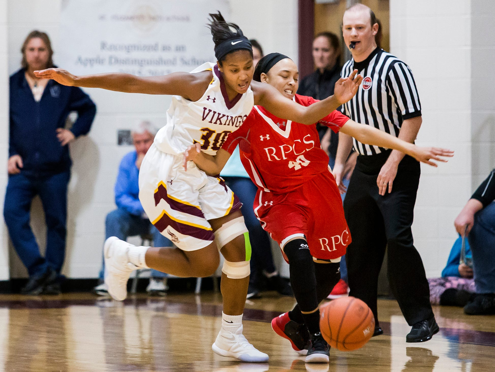 St. Elizabeth's Alanna Speaks (No. 30) steals the ball from Roland Park's Aniyah Carpenter in the first half of St. Elizabeth's 58-44 loss to Roland Park Country School in the Diamond State Classic at St. Elizabeth High School in Wilmington on Tuesday night.