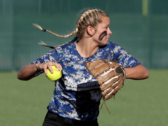 Windthorst's Tatum Veitenheimer throws to first in Game 1 of the Region I-2A quarterfinal against Archer City Thursday, May 11, 2017, at Midwestern State University's Mustang Field. The Lady Cats defeated the Trojanettes 4-3.