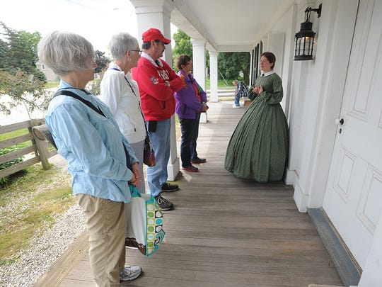 Andria Tatlock and Susan McFadden of Appleton, and Victor Abitz and Kathleen Burg of Fond du Lac, listen to a guide at the Wade House in Greenbush. Tuesday July 7, 2015.