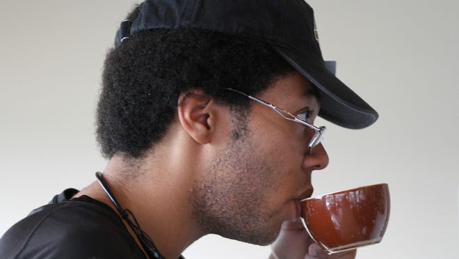 Marc Clark of Eatontown, a frequent customer at Eagle Specialty Coffee in Eatontown, sips a specialty coffee.