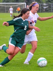 Everest's Maddie Mittelsteadt attempts to move past Memorial's Rebekah Gerry.