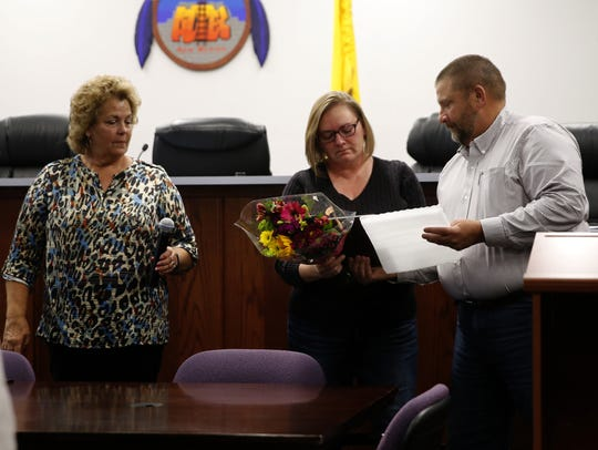 Commissioner Sherri Sipe, left, and interim city manager Steve Mueller, right, thank outgoing Mayor Sally Burbridge for her service Monday during a City Commission meeting at Aztec City Hall.