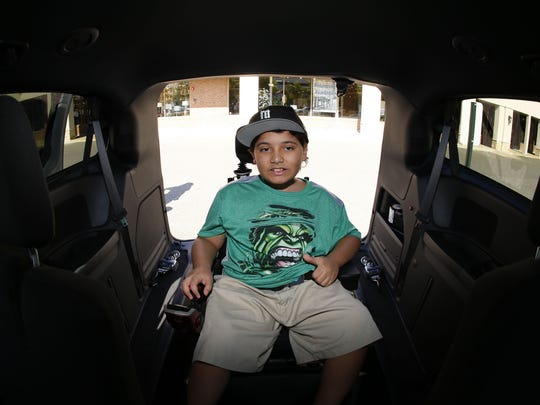 Damarius sits the new wheelchair accessible van donated by Capitol Lighting. Damarius has muscular dystrophy. Eatontown,NJ. Thursday, May 12,2016.Noah K. Murray-Correspondent/Asbury Park PressASB 0513 Damarius Van