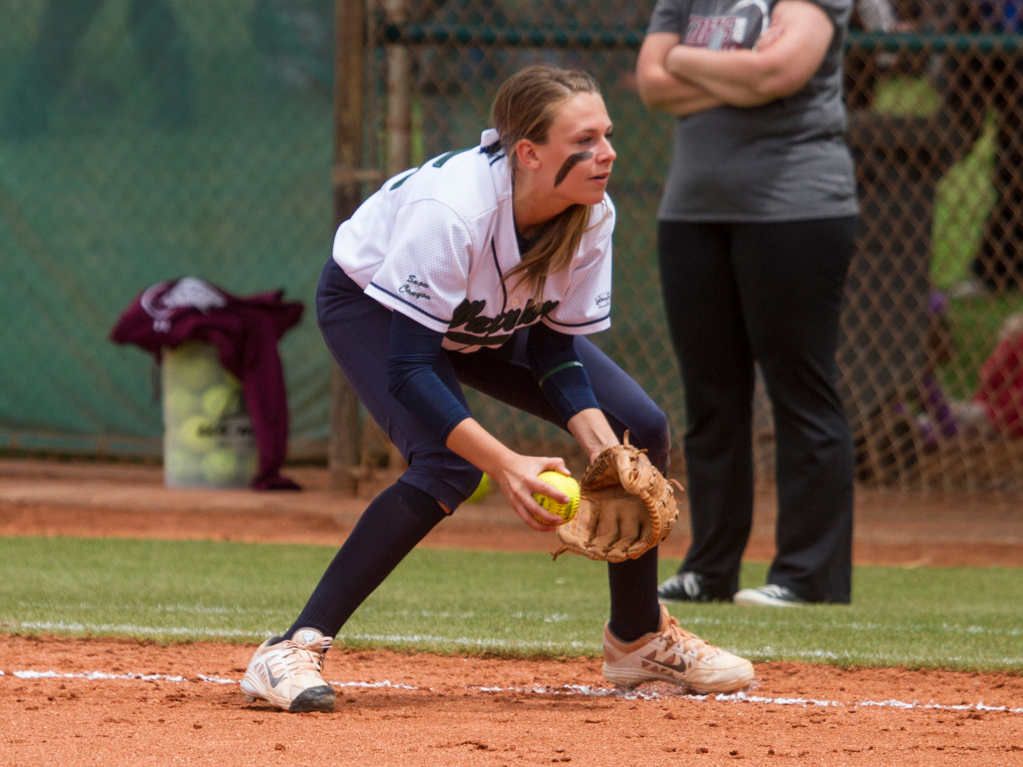Snow Canyon infielder Camryn Johnson fields a ball for the final out against Morgan on Saturday.